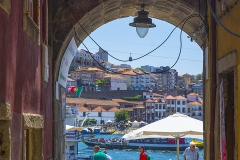 PORTO, PORTUGAL - JULY 21, 2017: One of the doors of the Fernandina wall, from the 14th century, that gives access to the banks of the Douro river, in the Ribeira neighborhood